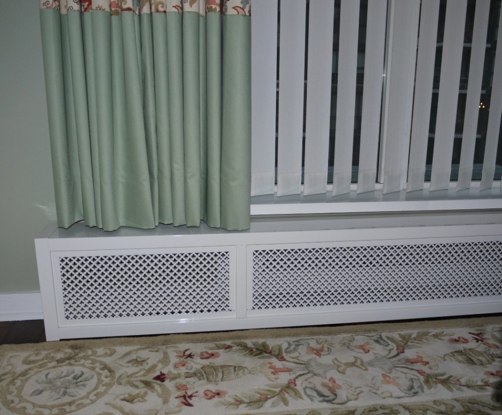 custom nursery drapes over top of a custom baseboard heater cover
