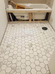 Hexagon marble pattern porcelain tile in bathroom renovation