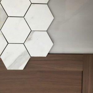 Hexagon tile, walnut cabinet door, grey field tile