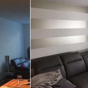 wallpaper with horizontal stripe behind sofa