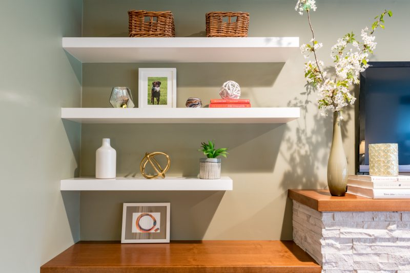 pictures and vases on floating shelves