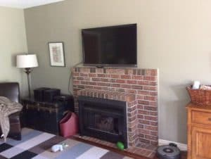 full wall view with red brick fireplace