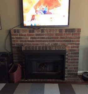 red brick fireplace surround before renovation