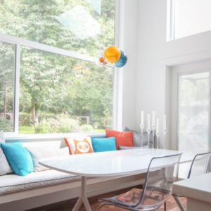 window bench with orange and turquoise colour accents
