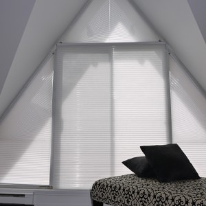 Honeycomb shades on specialty shaped windows