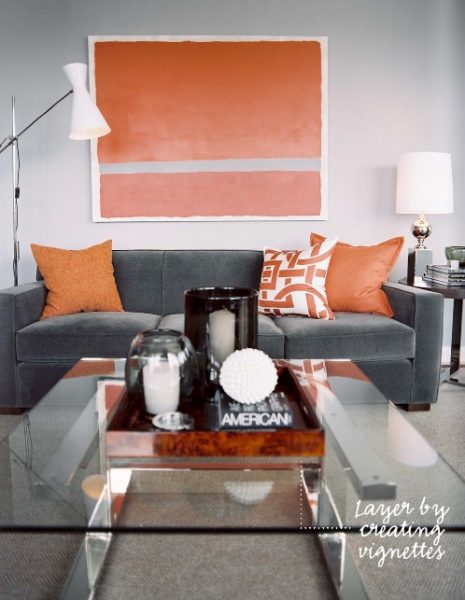 Orange accents on a grey backdrop