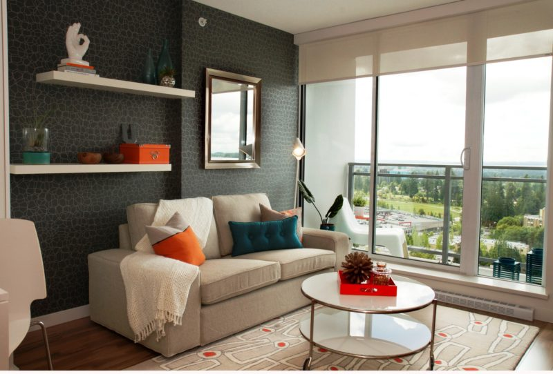 sofa, floating shelves, decorated small space