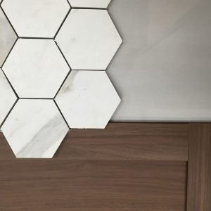 Hexagon tile, walnut cabinet door, grey field tile
