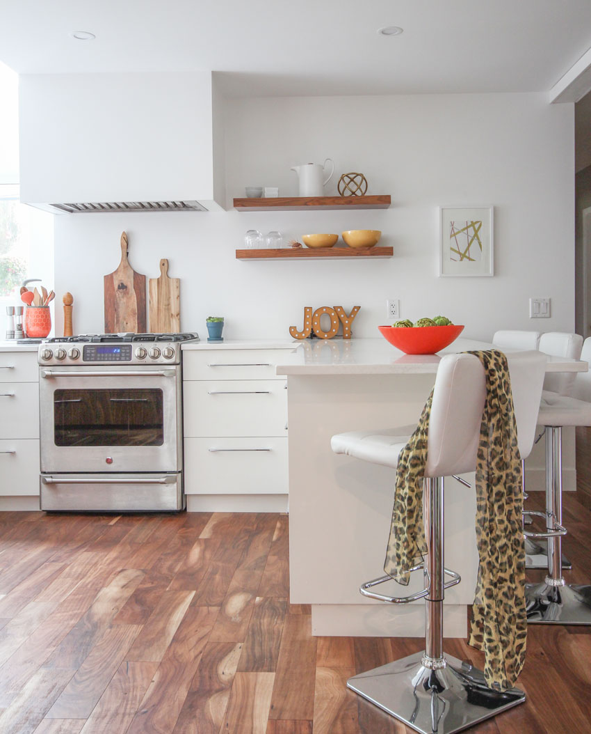 white-kitchen white-cabinets, acacia wood floors, orange accents,