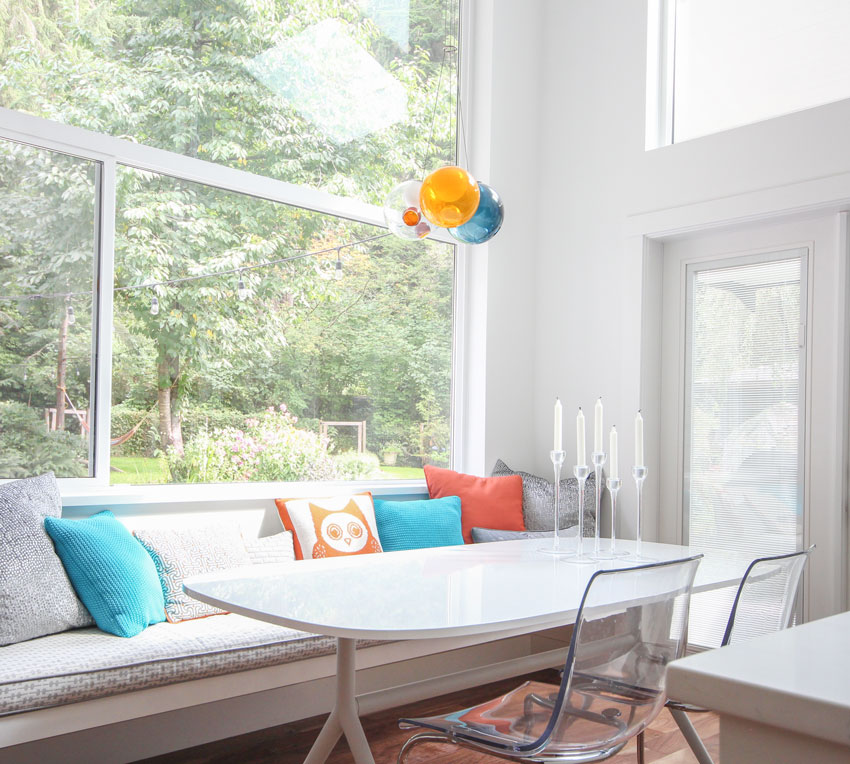 orange-turquoise-modern-interior-decorating-window-bench-ikea-table-chairs-bocci-chandelier-white-walls-North-Vancouver