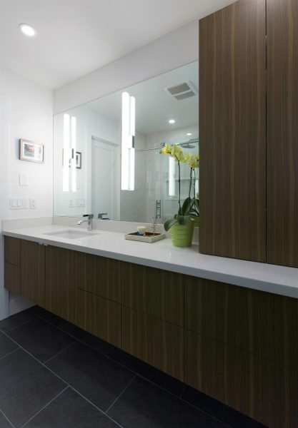 Ensuite-cabinets-walnut laminate, black floor tile, linear lights on mirror