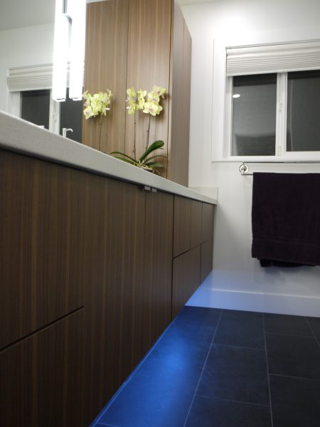 cabinets-after-walnut laminate, white walls, black floor tile, undercabinet lighting