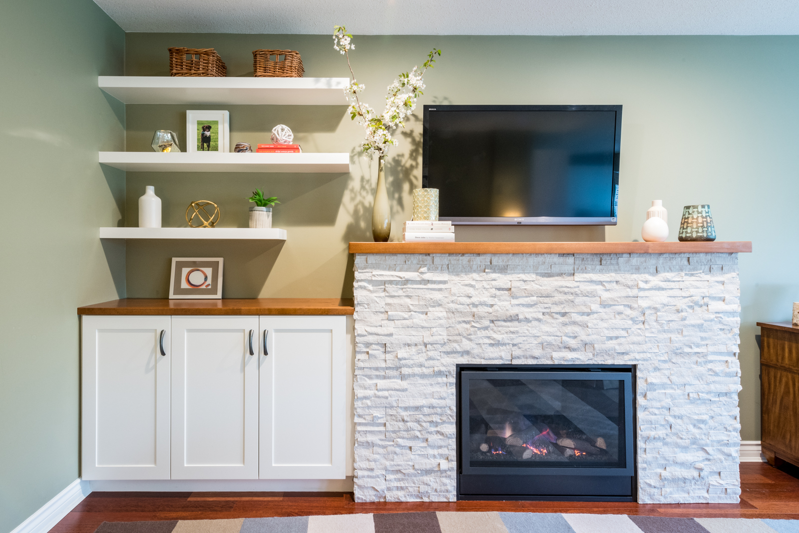 white floating shelves above a cabinet